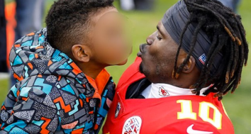 Tyreek Hill with his son
